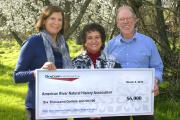 Aerojet Rocketdyne Foundation director Juanita Garcia (center) presents check to Effie Yeaw Nature Center