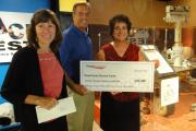 Aerojet Rocketdyne Foundation check to support the Powerhouse Science Center